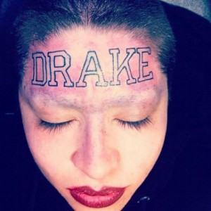 OMG:  Woman Gets Rapper's Name Tattooed on Her Forehead
