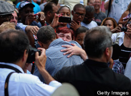 Obama receives tearful hug and thanks for health care law