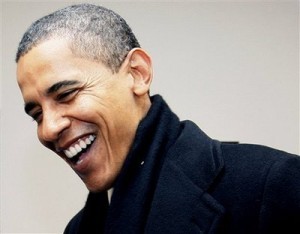 Obama laughing 300x234 President Obama Jokingly Calls Romney a 'Bullsh*tter' in Rolling Stone Interview