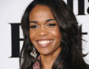 Michelle Williams took the high road on her Super Bowl critics by telling women that we must stick together and support each other.